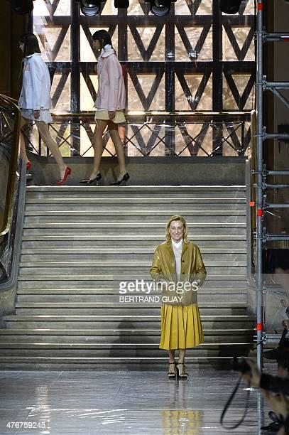 Italian fashion designer Miuccia Prada acknowledges the audience at the end of Miu Miu 2014/2015 Autumn/Winter ready-to-wear collection fashion show,...