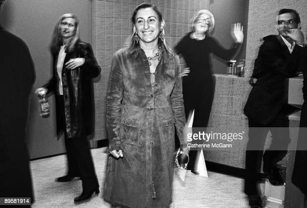 Italian fashion designer Miuccia Prada, center, backstage at the VH1 Fashion Awards in October 1998 in New York City, New York.