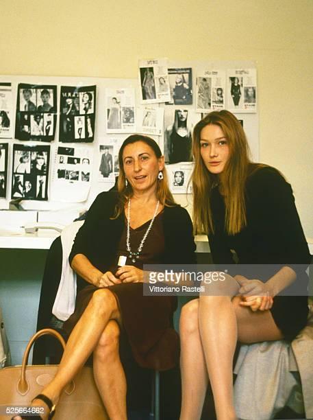 Italian fashion designer Miuccia Prada with Italian-French top model Carla Bruni.