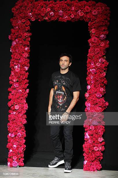 Italian fashion designer Ricardo Tisci appears at the end of his Men's fall-winter 2011-2012 ready-to-wear collection show for Givenchy fashion house...