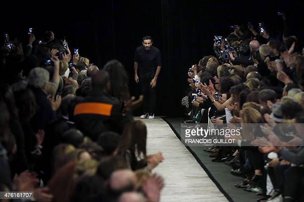 Italian fashion designer Riccardo Tisci acknowledges the audience at the end of the Givenchy 2014/2015 Autumn/Winter readytowear collection fashion...