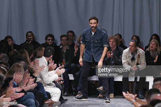 Italian fashion designer Riccardo Tisci for Givenchy acknowledges the public at the end of his Spring/Summer 2013 ready-to-wear collection show on...