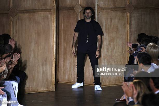 Italian fashion designer Riccardo Tisci for Givenchy acknowledges the audience at the end of his spring-summer 2012 men's fashion collection show, on...