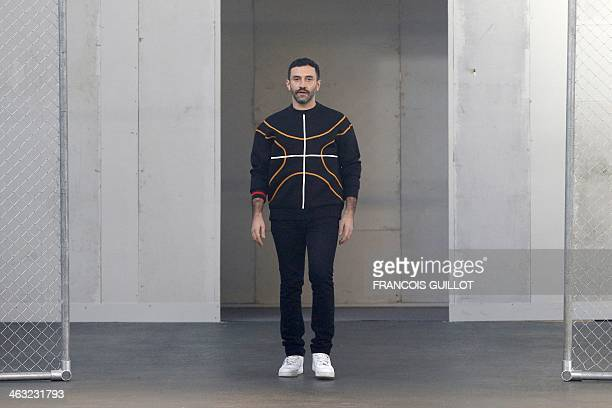 Italian fashion designer Riccardo Tisci for Givenchy acknowledges the public during the Givenchy's Fall/Winter 2014-2015 men's fashion show in Paris...