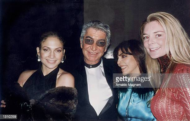 Italian fashion designer Roberto Cavalli center poses with actress Jennifer Lopez left Veronica Castro second right and an unidentified woman at the...