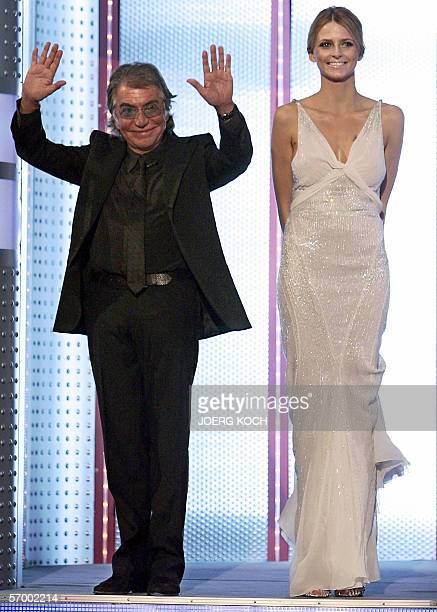 Italian fashion designer Roberto Cavalli waves as he arrives with German top model Eva Padberg for the live broadcast of the TV show 'Wetten dass '...