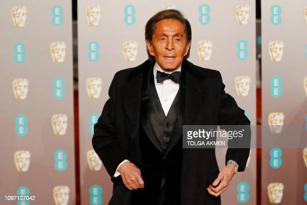Italian fashion designer Valentino Garavani poses on the red carpet upon arrival at the BAFTA British Academy Film Awards at the Royal Albert Hall in...