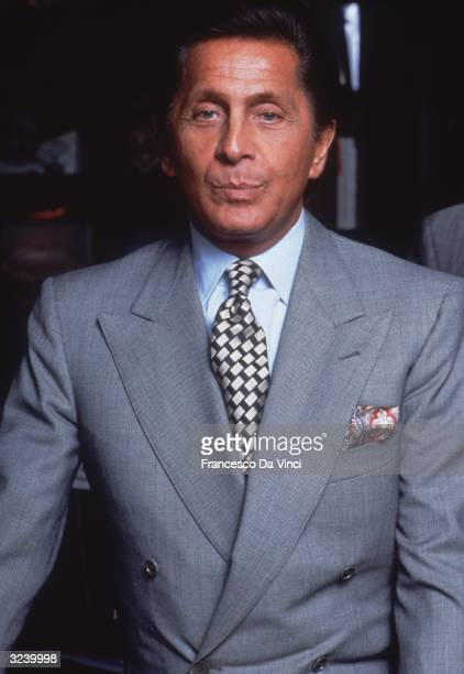 Italian fashion designer Valentino wearing a grey doublebreasted suit jacket and patterned tie