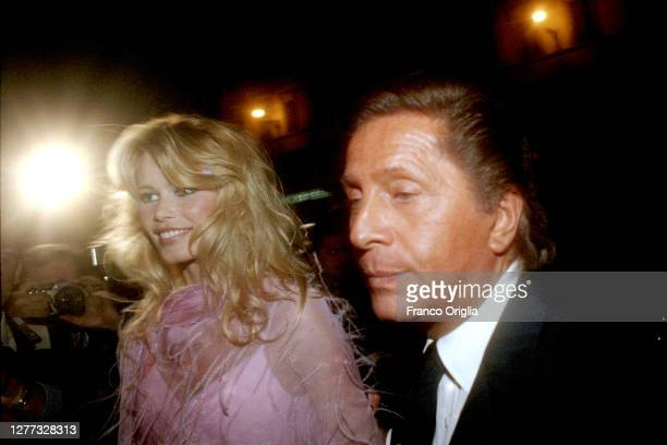 Italian fashion designer Valentino, whose real name is Valentino Garavani, and top model Claudia Schiffer attend a party for the inauguration of...