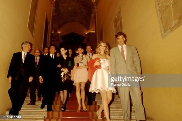 Italian fashion designer Valentino, whose real name is Valentino Garavani, Giancarlo Giammetti and top model Claudia Schiffere attend a party...