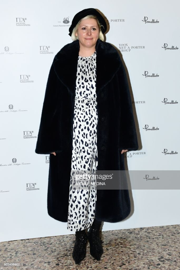Italian fashion designer Vivetta Ponti poses upon the arrival to the exhibition preview of 'Italiana, Italy Through the Lens of Fashion' at Palazzo Reale in Milan, on February 21, 2018. / AFP PHOTO / Miguel MEDINA