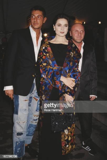 Italian fashion designers Domenico Dolce and Stefano Gabanna with Italian actress Isabella Rossellini at the Metropolitan Museum Gala New York City...