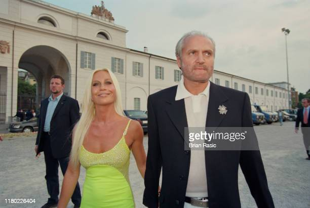 Italian fashion designers Gianni Versace and Donatella Versace attend the Pavarotti and Friends for War Child benefit concert at Parco Novi Sad in...
