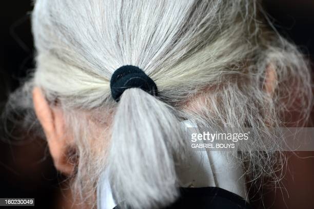 Italian fashion house Fendi's designer Karl Lagerfeld reacts during a press conference announcing Fendi would finance a renovation of the Trevi...
