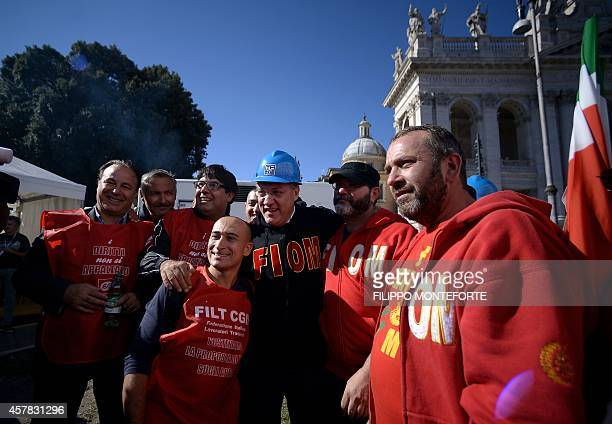 Italian federation of metalworkers union general secretary Maurizio Landini poses with workers in San Giovanni square during a demonstration...