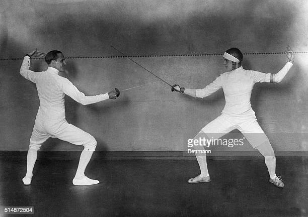 Italian fencer Nedo Nadi , winner of gold medals in fencing in the 1912 and 1920 Olympic Games, fences with German fencer Helene Mayer, herself an...
