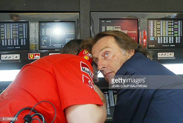 Italian Ferrari and Fiat manager Luca Cordero di Montezemolo talks to British Ferrari technical manager Ross Brawn in the pit wall of the Monza...