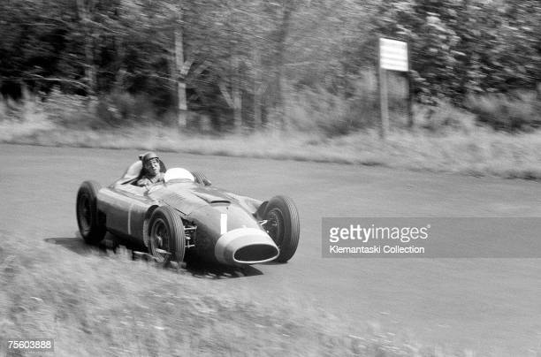 Italian Ferrari driver Juan Manuel Fangio, driving through the Hatzenbach 'S' bends on his way to victory during the German Grand Prix at the...