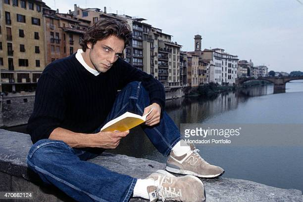 'Italian fiction and theater actor Alessandro Preziosi is portrayed on the parapet of Ponte Vecchio while addressing a look to the camera and thus...