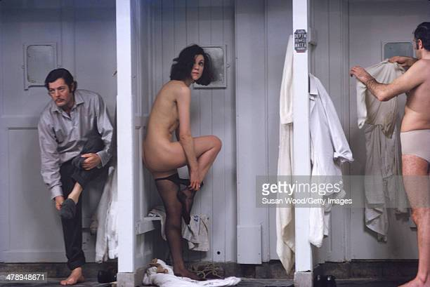 Italian film actor Marcello Mastroianni and other actors undress in changing stalls in a scene from the film 'Leo the Last' England 1970