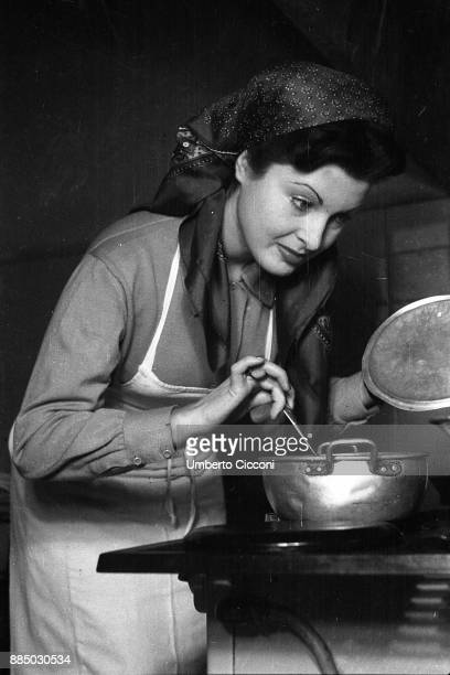 Italian film actress and director Silvana Pampanini cooks in her flat Rome 1948