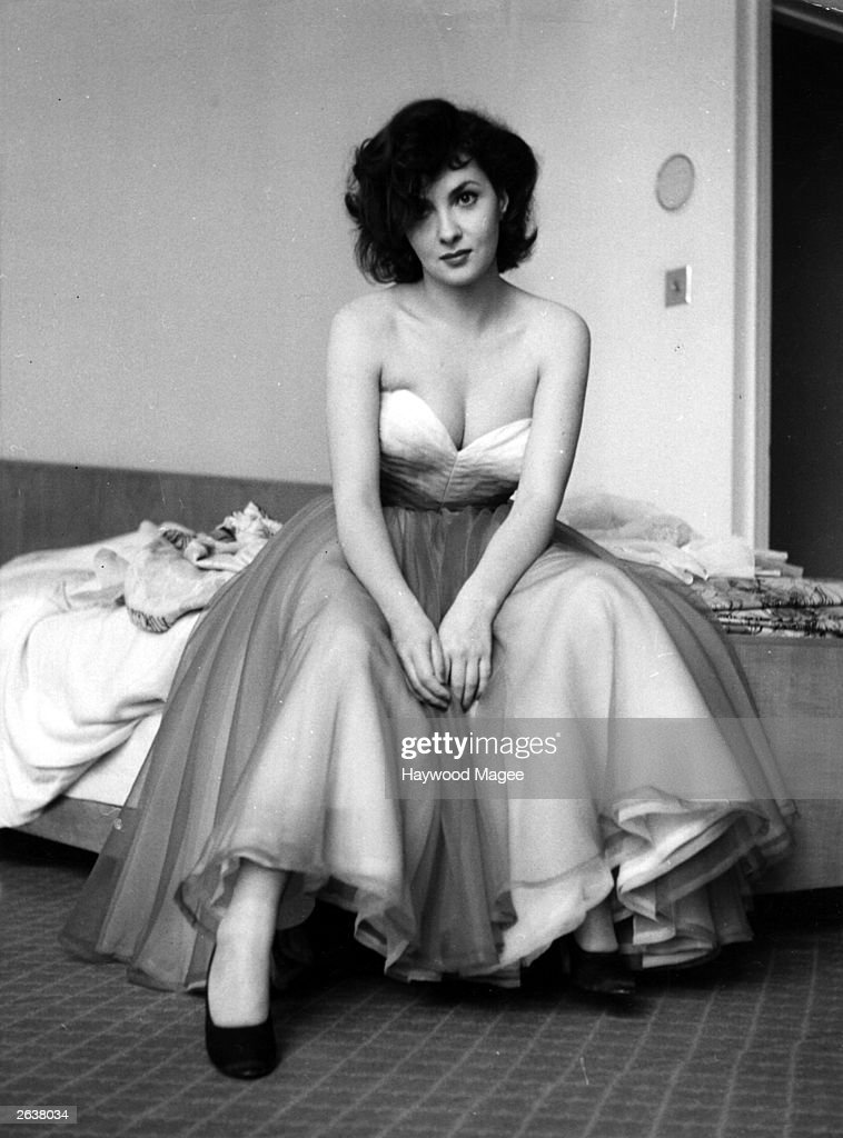 Italian film actress Gina Lollobrigida wearing an evening dress. Original Publication: Picture Post - 5952 - Stars Bring Fashions From Italy - pub. 1952