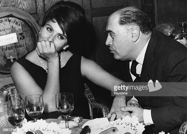 Italian film actress Sophia Loren in a restaurant in France with her husband Carlo Ponti the man credited with discovering her