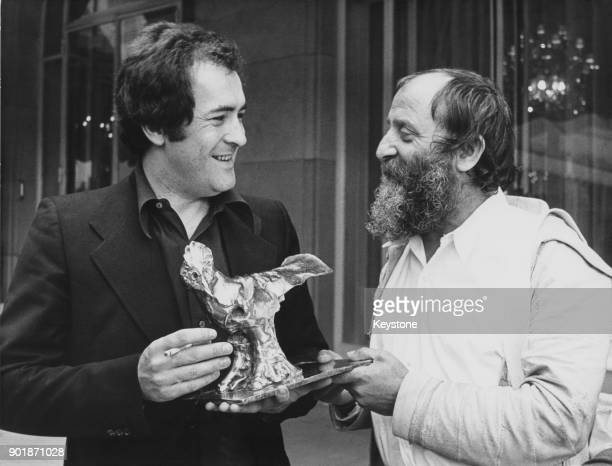 Italian film director Bernardo Bertolucci with the Raoul Levy prize awarded to him for 'Last Tango in Paris' 4th May 1973 On the right is French...