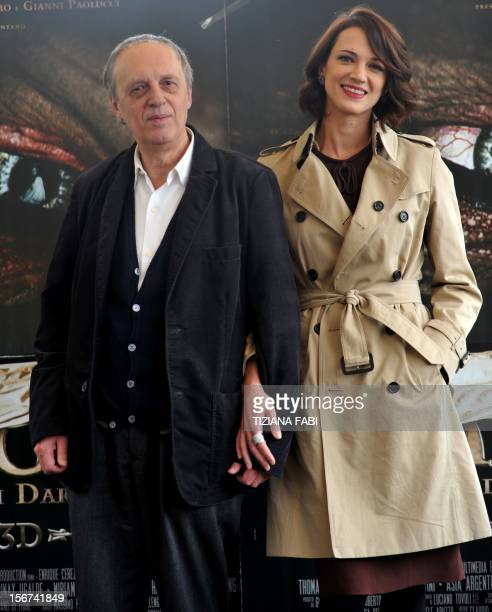 Italian film director Dario Argento and daughter actress Asia Argento pose during a photocall for Dracula 3D on November 20 2012 in a hotel in Rome...