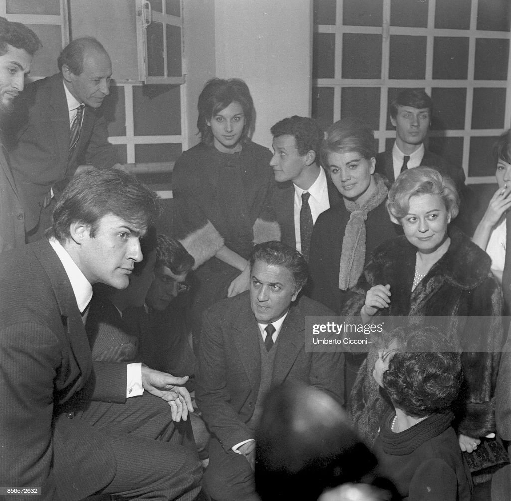 Film director Federico Fellini, actress Giulietta Masina and their students at the inauguration of the school 'Al Fersen', Rome 1961 : News Photo