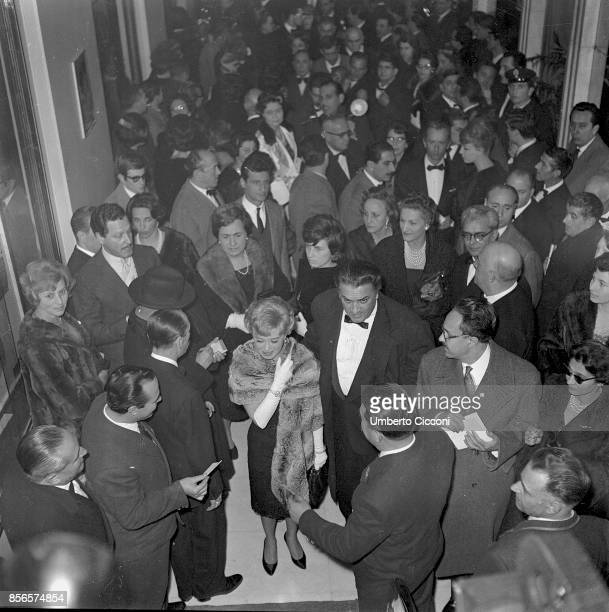 Italian film director Federico Fellini at the 'Cinema Fiamma' for the premiere of 'La Dolce Vita' movie with his wife and actress Giulietta Masina...