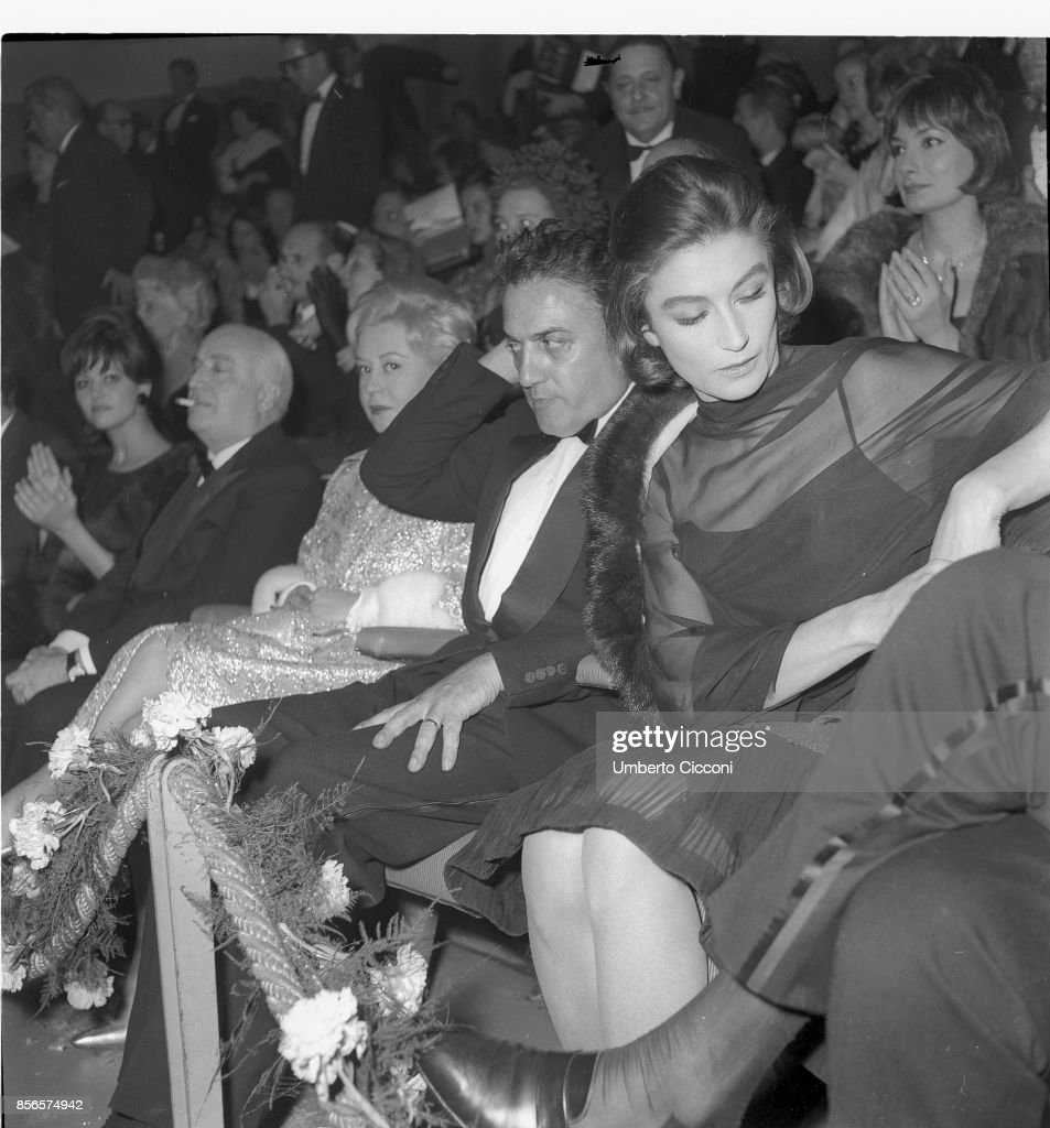 Film director Federico Fellini at the 'Cinema Fiamma' with Angelo Rizzoli (left), Giulietta Masina and Anouk Aimee in 1963 : News Photo