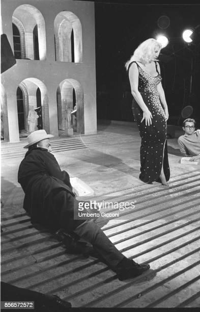 Italian film director Federico Fellini directing actress Anita Ekberg during the shooting of the movie 'Boccaccio '70' Rome EUR 1961
