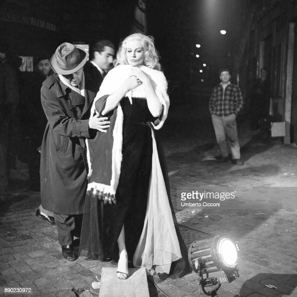 Italian film director Federico Fellini directing actress Anita Ekberg during the shooting of movie 'La Dolce Vita' Rome 1959