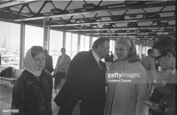 Italian film director Federico Fellini is at Fiumicino Airport with his wife and actress Giulietta Masina and actress Sandra Milo leaving for a trip...