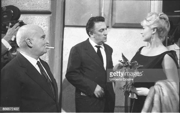 Italian film director Federico Fellini is talking with the actress Anita Ekberg and the Italian film producer and publisher Angelo Rizzoli Rome...