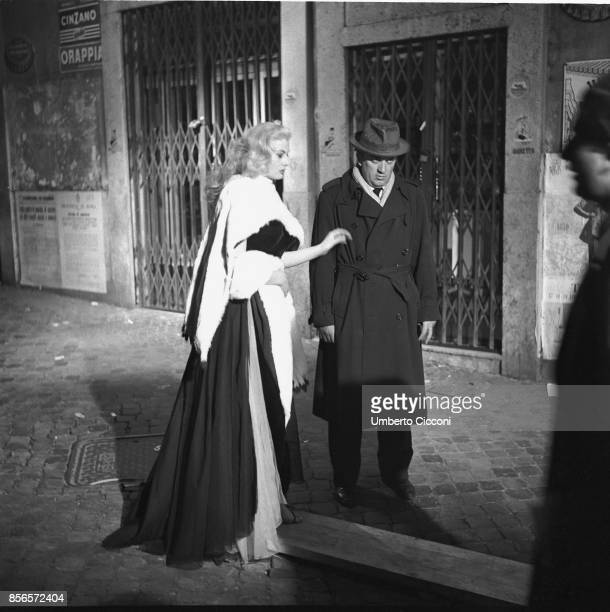 Italian film director Federico Fellini is with actress Anita Ekberg during the shooting of the movie 'La Dolce Vita' They are close to 'Trevi...