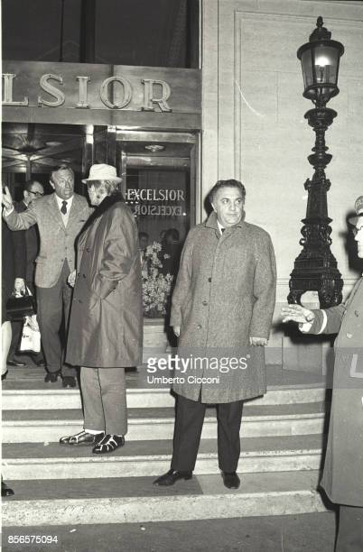Italian film director Federico Fellini is with the American actor Danny Kaye in front of the Excelsior Hotel in Rome 1968