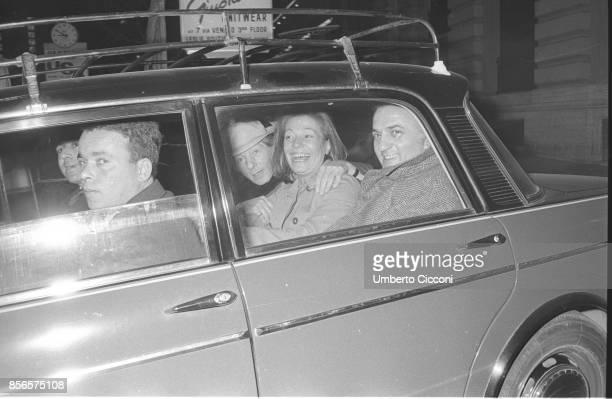 Italian film director Federico Fellini is with the American actor Danny Kaye in a car in front of the Excelsior Hotel in Rome 1968