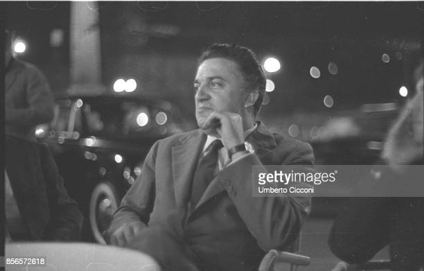 Italian film director Federico Fellini seats in a cafe in Via Veneto Rome 1960 He is very relaxed and smiling