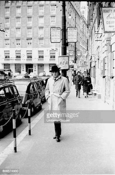Italian film director Federico Fellini walking in Rome in February 1963