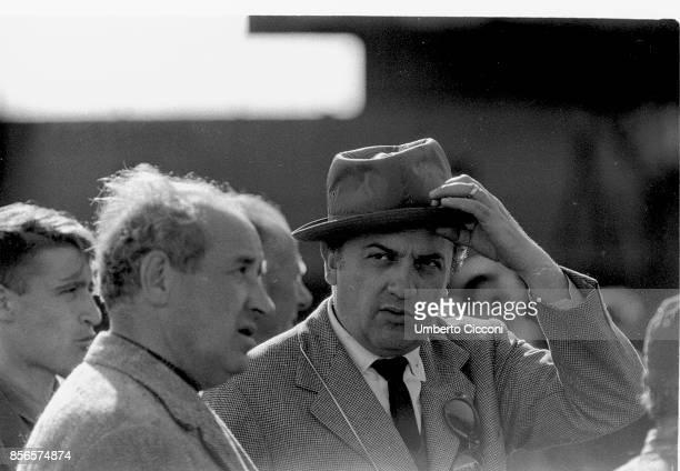 Italian film director Federico Fellini wearing a hat in Ciampino Rome 1959