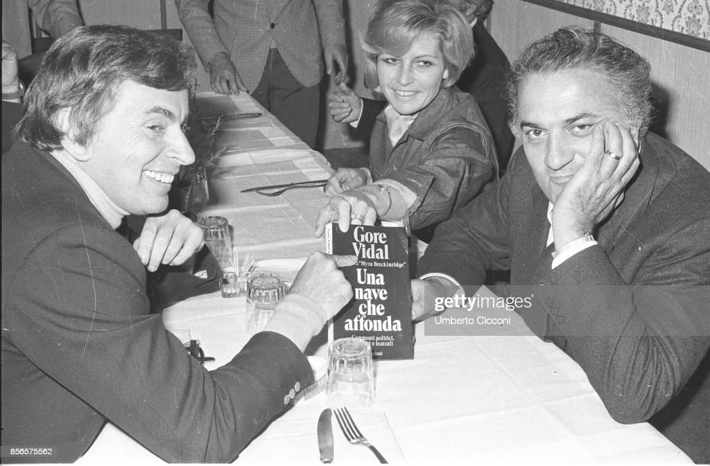Film director Federico Fellini with Gore Vidal and Giulietta Masina having dinner together, Rome 1971 : News Photo