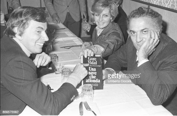 Italian film director Federico Fellini with American writer and public intellectual Gore Vidal and Giulietta Masina They are having dinner together...