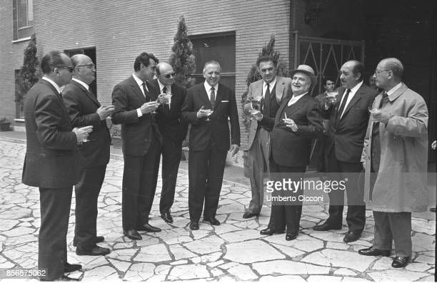 Italian film director Federico Fellini with Francesco Rosi Walter Chiari Achille Corona Angelo Rizzoli and Saro Urzi at the Sala Palatino for a...