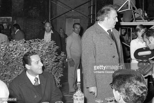 Italian film director Federico Fellini with Italian actor Alberto Sordi at Cinecittà studios Rome 1971