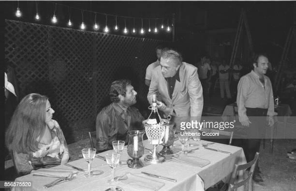 Italian film director Federico Fellini with Italian actor Marcello Mastroianni and Italian cinematographer Giuseppe Rotunno during the shooting of...