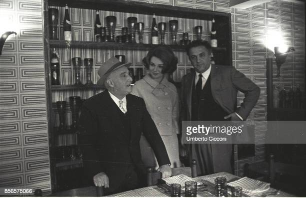 Italian film director Federico Fellini with the Italian publisher and film producer Angelo Rizzoli and the actress Sylva Koscina together for a...