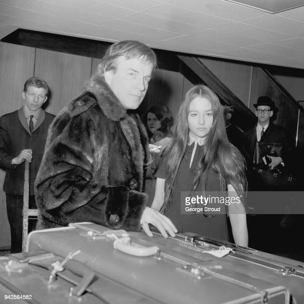 Italian film director Franco Zeffirelli with EnglishArgentine actress Olivia Hussey at Heathrow Airport London UK 20th March 1968