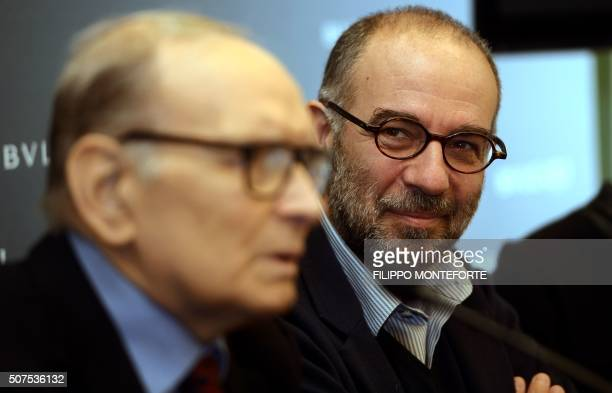 Italian film director Giuseppe Tornatore watches Italian composer orchestrator conductor Ennio Morricone speaking as he receives the 2016 Golden...